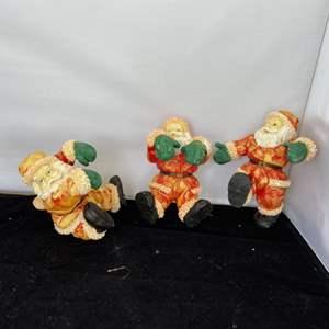 Lot # 55 Green Glove Santa Figurines