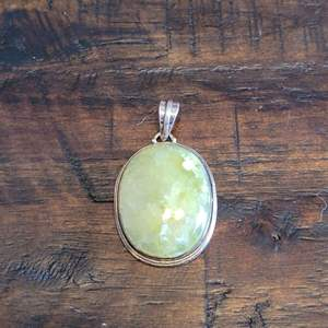 Lot # 108 Gorgeous Stone Pendant w/ Sterling Wrap