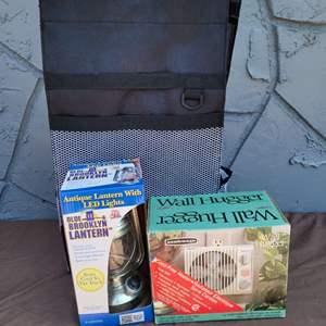 Lot # 243 Wall Hugger Cordless Heater, LED Lantern, & Rolling Carry All Bag
