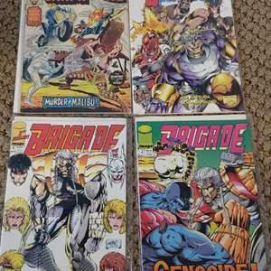 Lot # 456 (1) Champions & (2)Brigade Comics