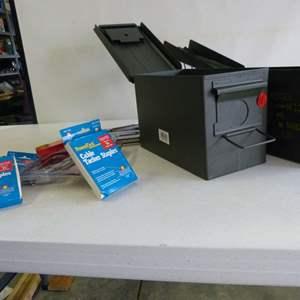 Lot # 11  2 outdoorsman boxes +  1 new stapler & 1 like new stapler & staples