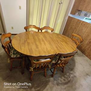 #50. table and six wooden chairs in the dining room