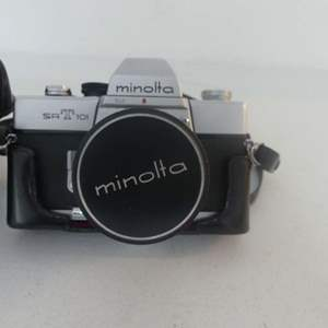 Lot #78 Minolta SRT-101 35mm SLR (Single Lens Reflex) Camera in Leather Case