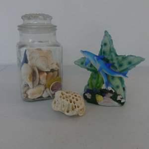 Lot #123 Jar of Seashells, Coral Paperweight and Beautiful Glittery Dolphin & Starfish Figurine