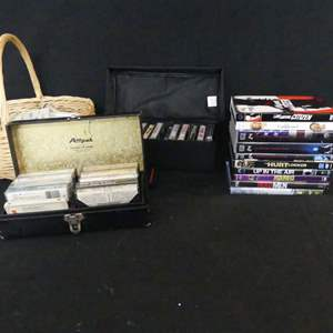Lot #143 Cassette Tapes and DVDs - Basket and Cases Included