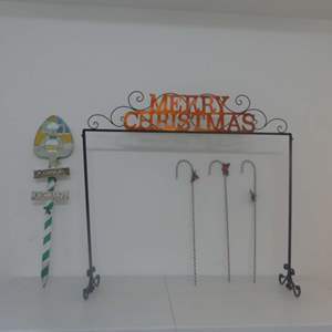 """Lot #215 Merry Christmas Glitter Stocking Holder, Happy Holidays Painted Shovel Signpost and Candy Cane """"Stakes"""""""