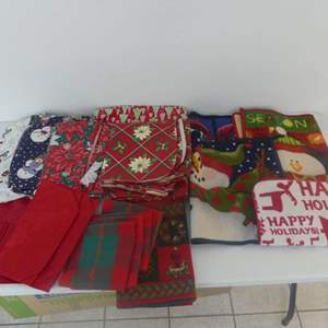 Lot #219 Bin of Holiday Table Coverings (Mostly Vinyl), Runners, Placemats, Napkins and Rugs/Mats - Bin Included
