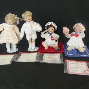 Lot #299 4 Ashton Drake Moments to Remember by Yolanda Bello Porcelain Dolls - With COAs (See Description)