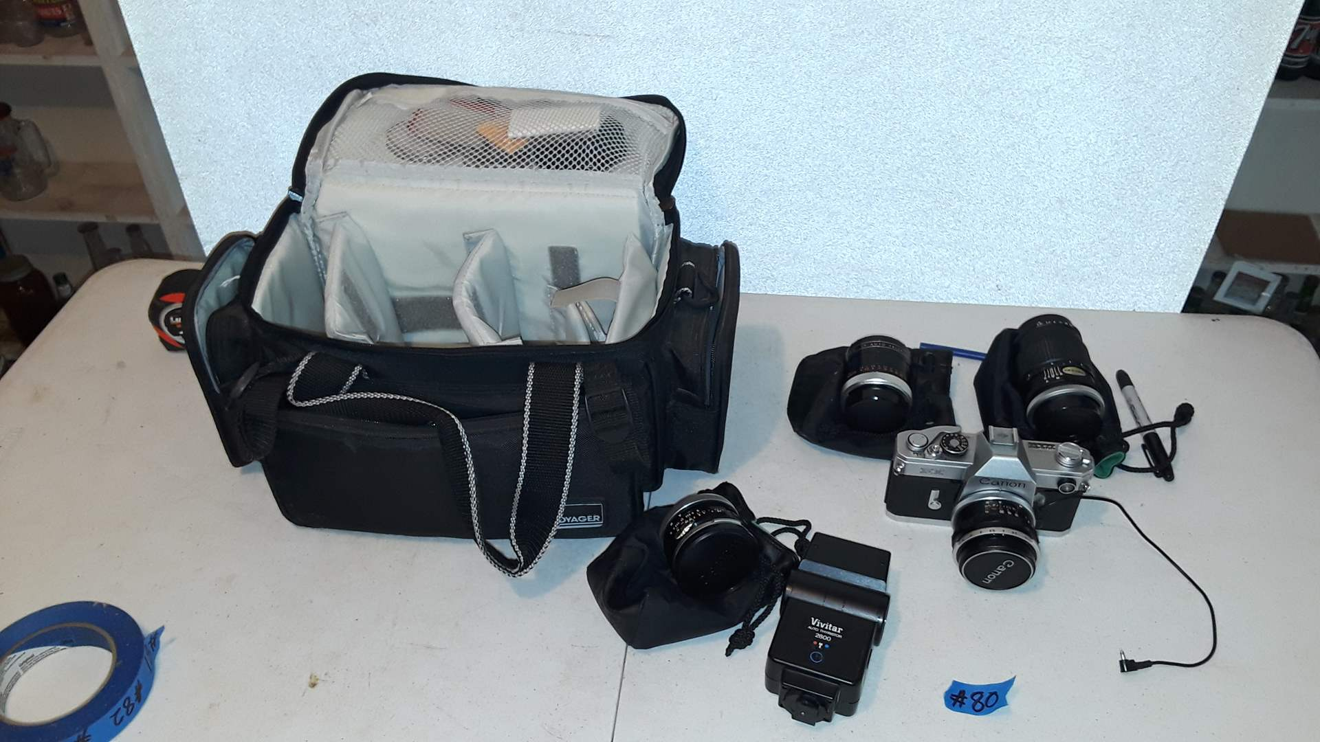 Lot # 80 CANON FX CAMERA WITH 3 EXTRA LENSES AND TRAVEL BAG