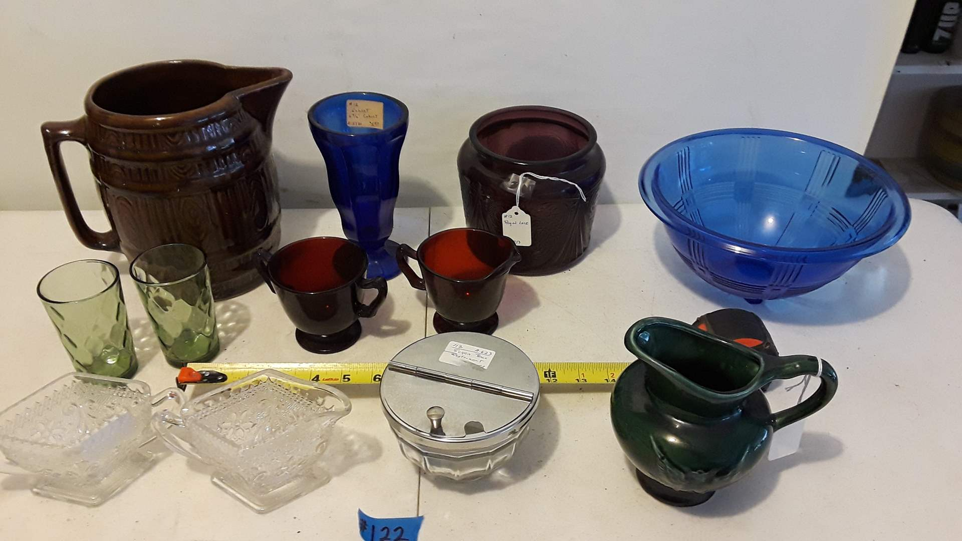 Lot # 122 COLLECTABLE GLASSWARE AND POTTERY, HEAVY BROWN STONEWARE PITCHER, HULL EAGLE, ANTIQUE BLUE BOWL , CREAMER  AND SUGAR