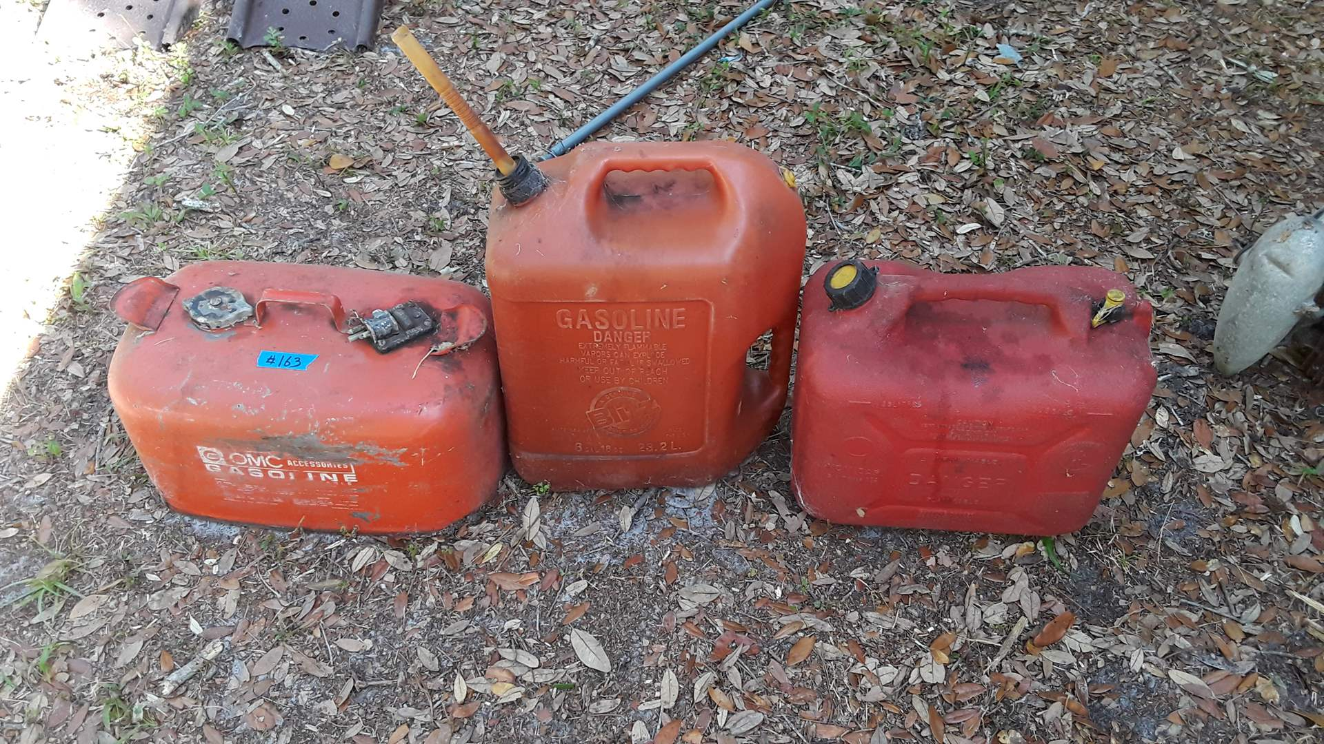 Lot # 163 LARGE METAL AND PLASTIC GAS CANS