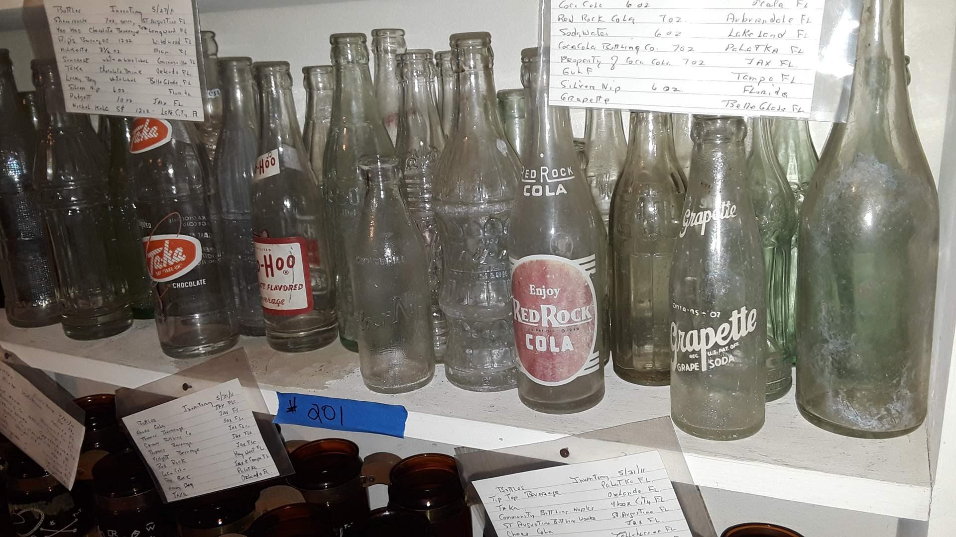 Lot # 201 COLLECTIBLE SODA BOTTLES, TA-KA, YOO HOO, RED ROCK, GRAPETTE