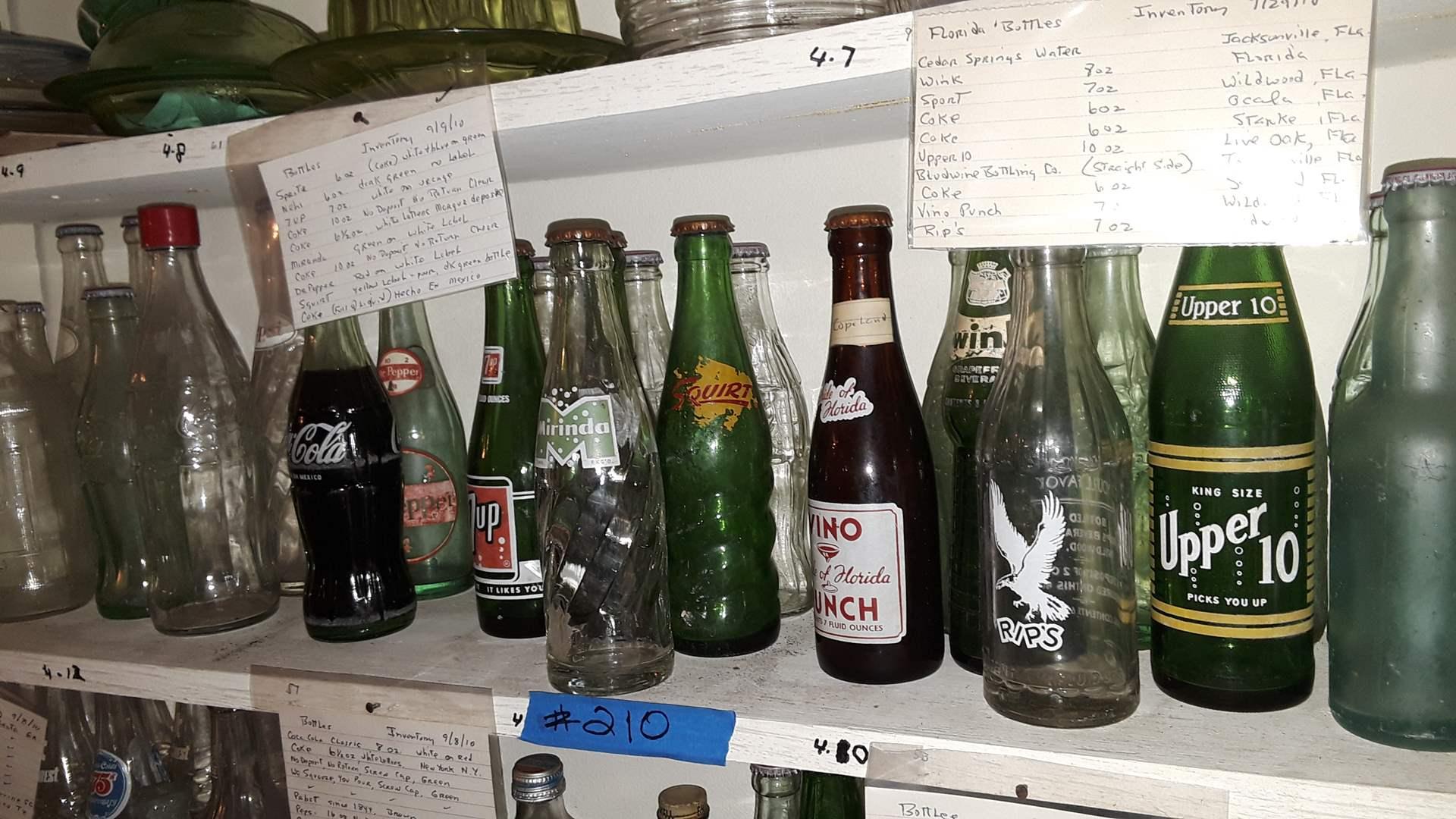 Lot # 210 COLLECTIBLE SODA BOTTLES,  VINO PUNCH FL, UPPER 10, SQUIRT