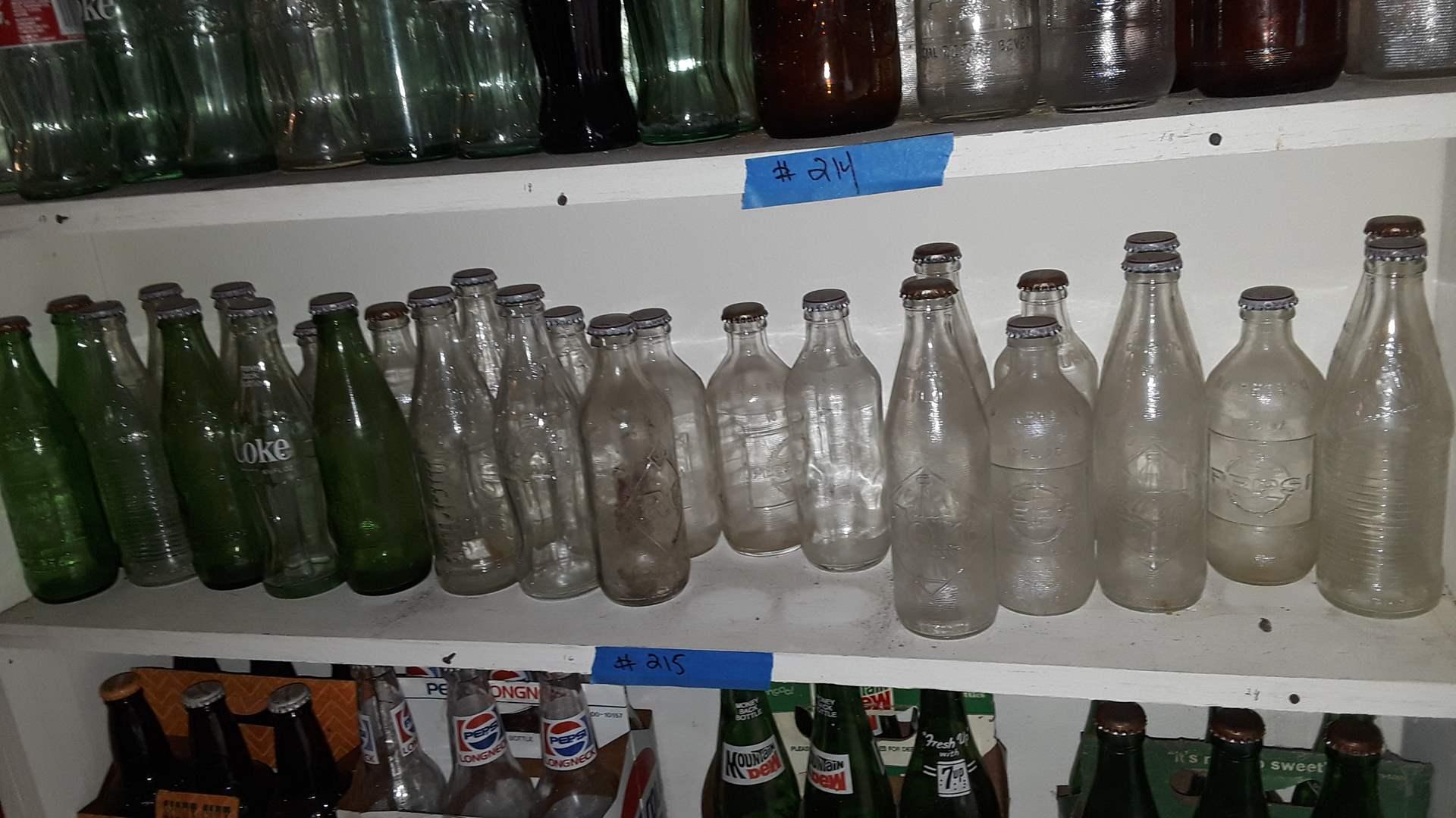 Lot # 215 COLLECTIBLE SODA BOTTLES,  EMBOSSED COKE, PEPSI, 7-UP