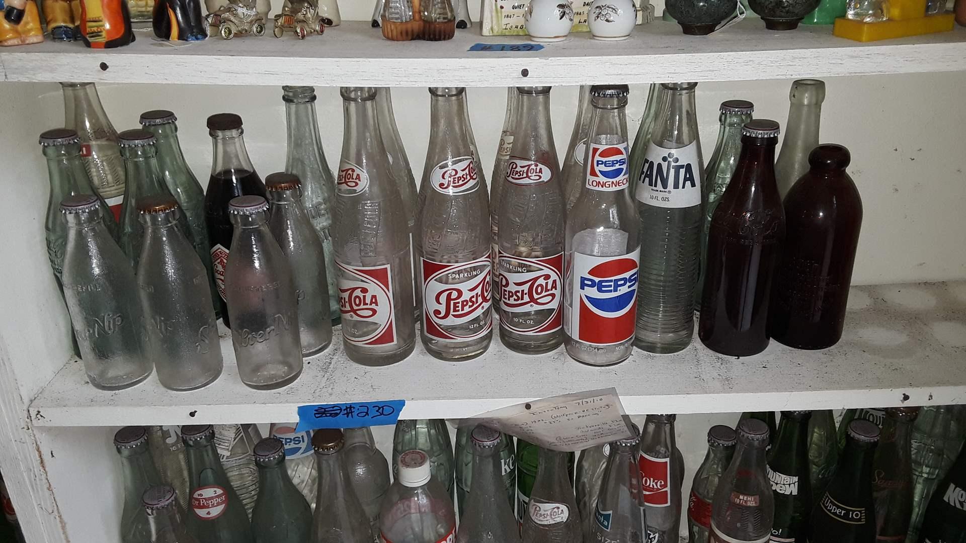Lot # 230 COLLECTIBLE SODA BOTTLES, PEPSI COLA RED LETTERING, FANTA, COKE, SILVER NIP JUICE BOTTLES