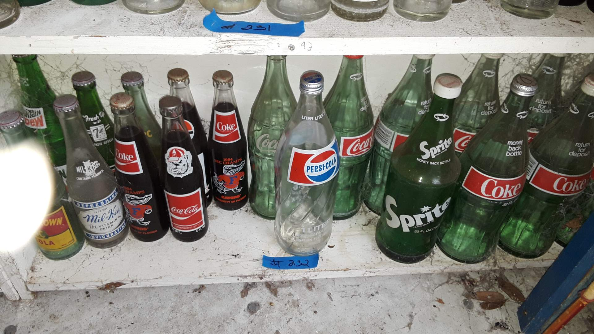 Lot # 232 COLLECTIBLE SODA BOTTLES,1984 GATORS, BULLDOGS,