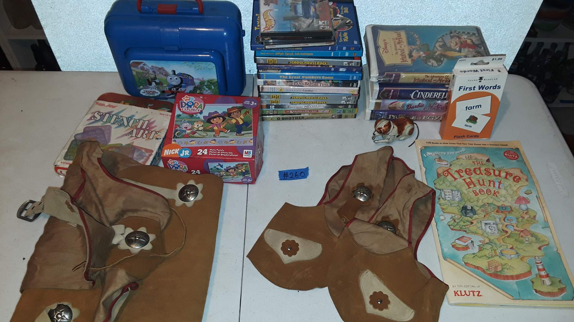 Lot # 260 CHILDRENS DVD'S, VCR TAPES, VINTAGE METAL DOG AND DISNEY CUP