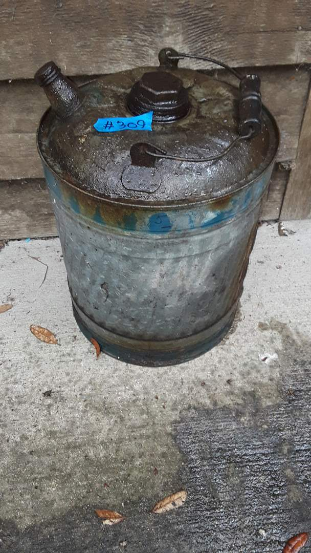 Lot # 309 LARGE GALVANIZED GAS CAN, HAD GAS IN IT, DOESN'T LEAK, VERY DIRTY