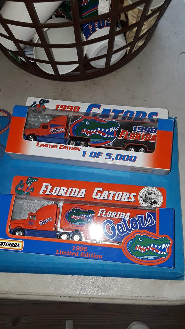Lot # 368 FLORIDA GATORS FOOTBALL, BASKETBALL COLLECTIBLES POSTERS, DIE CAST TRUCKS,