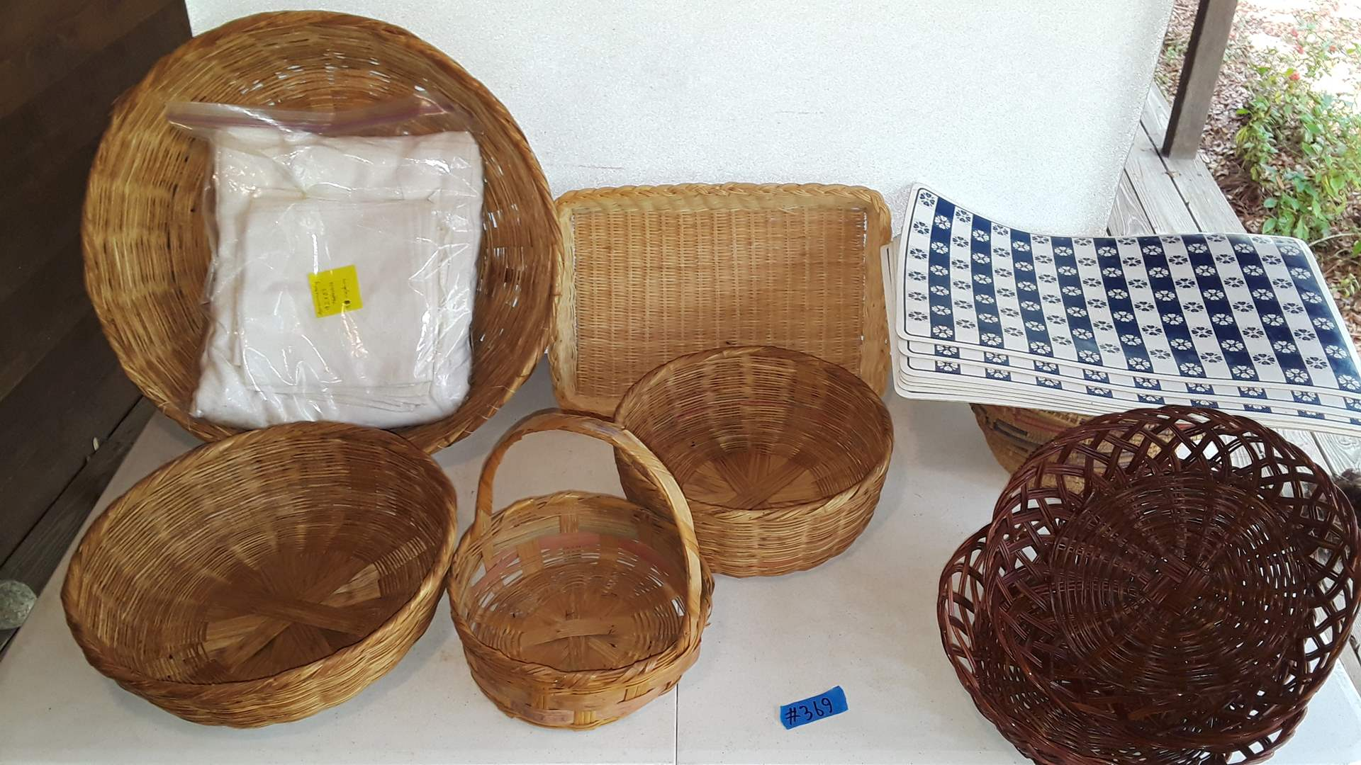 """Lot # 369 MIXED BASKETS, BEADS AND 95"""" X 53"""" TABLECLOTH WITH NAPKINS"""
