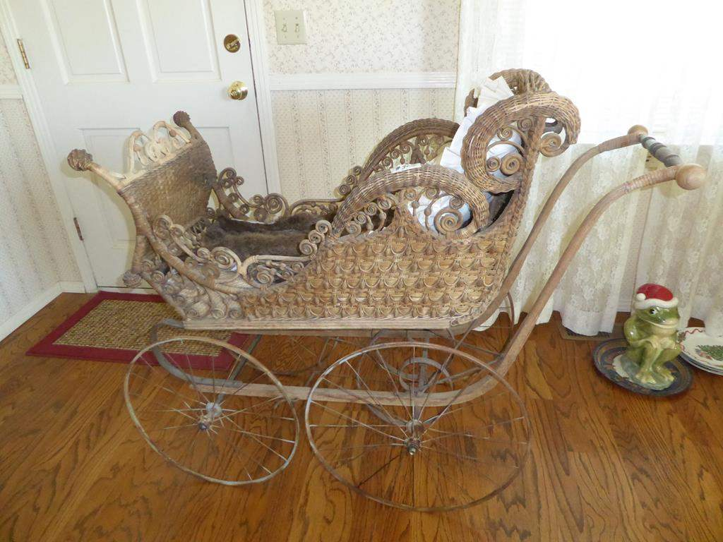 Lot # 300 - Beautiful Victorian Wicker Baby Carriage (main image)