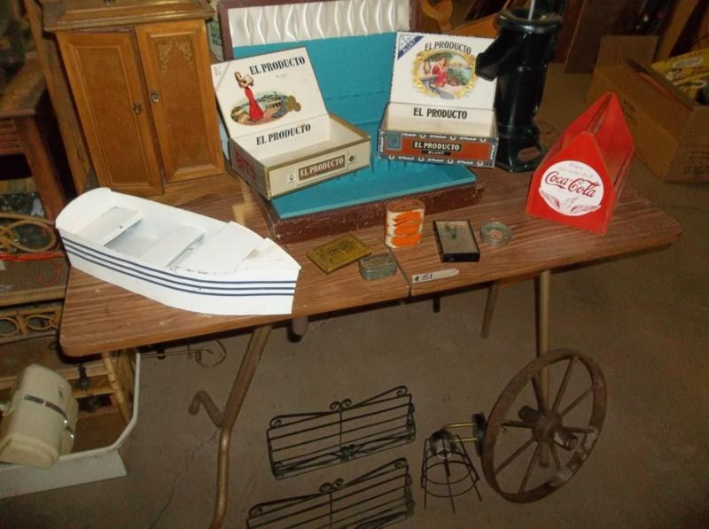 Lot #51 Folding Table with Contents, Old Tins, Game, Water Pump, Wrought Iron Spice Racks (main image)