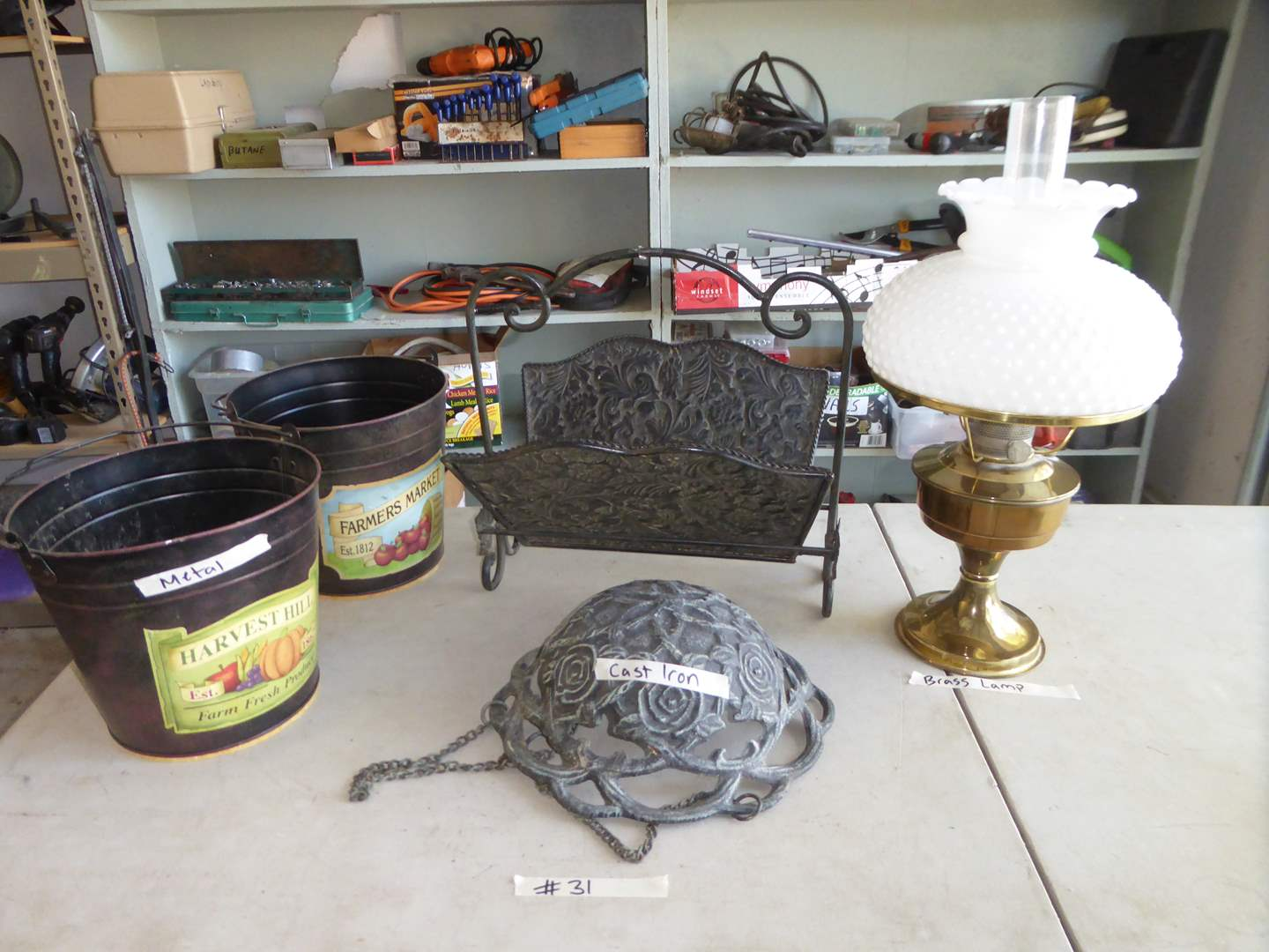 Lot # 31 - Small Brass Lamp, Cast Iron Basket & Metal Cans  (main image)