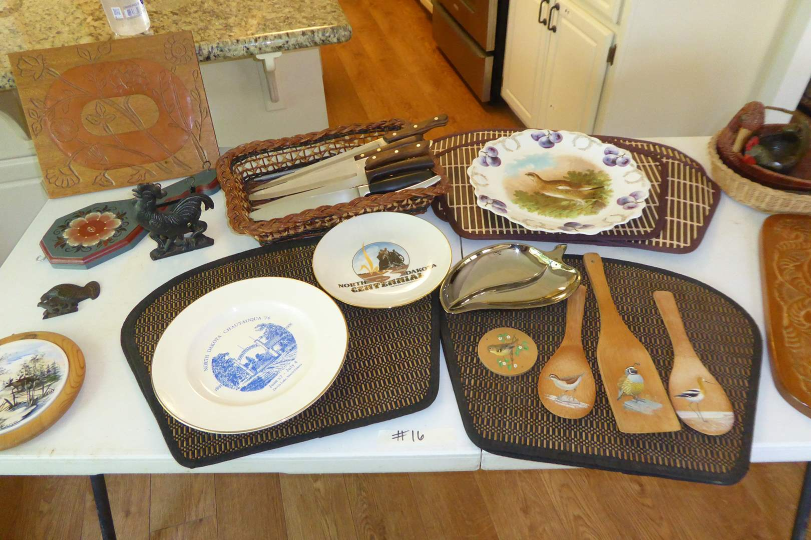 Lot # 16 - Placemats, Knives, Collectible Plates & Wooden Wall Hangings   (main image)