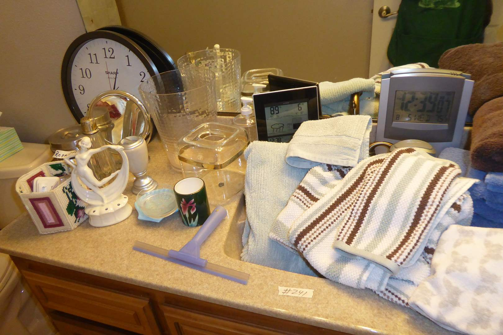 Lot # 241 - Bathroom Lot (Shower Curtain, Rug, Clocks Towels & More) (main image)