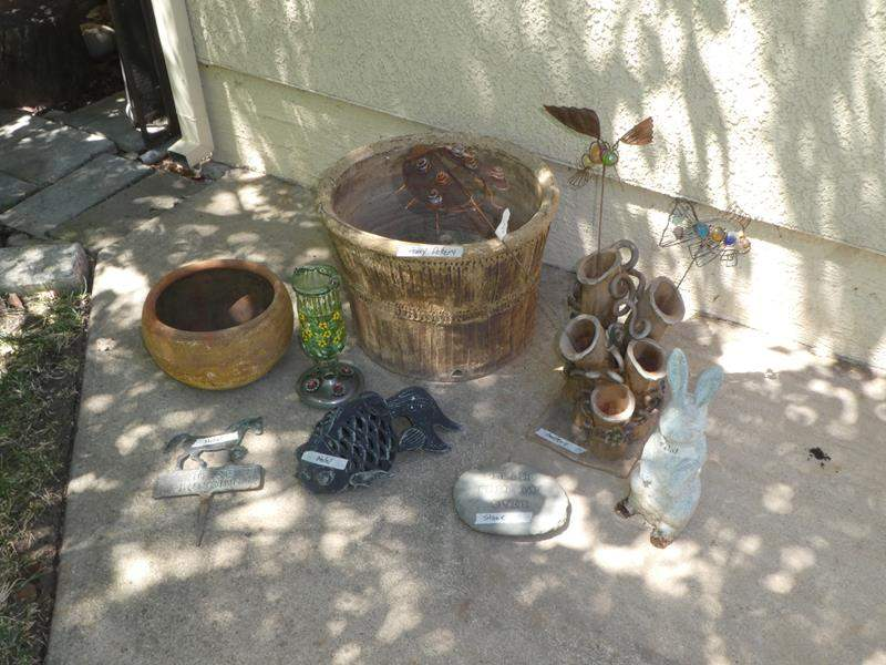 Lot # 274 - Pottery Planter & Metal Yard Decor   (main image)