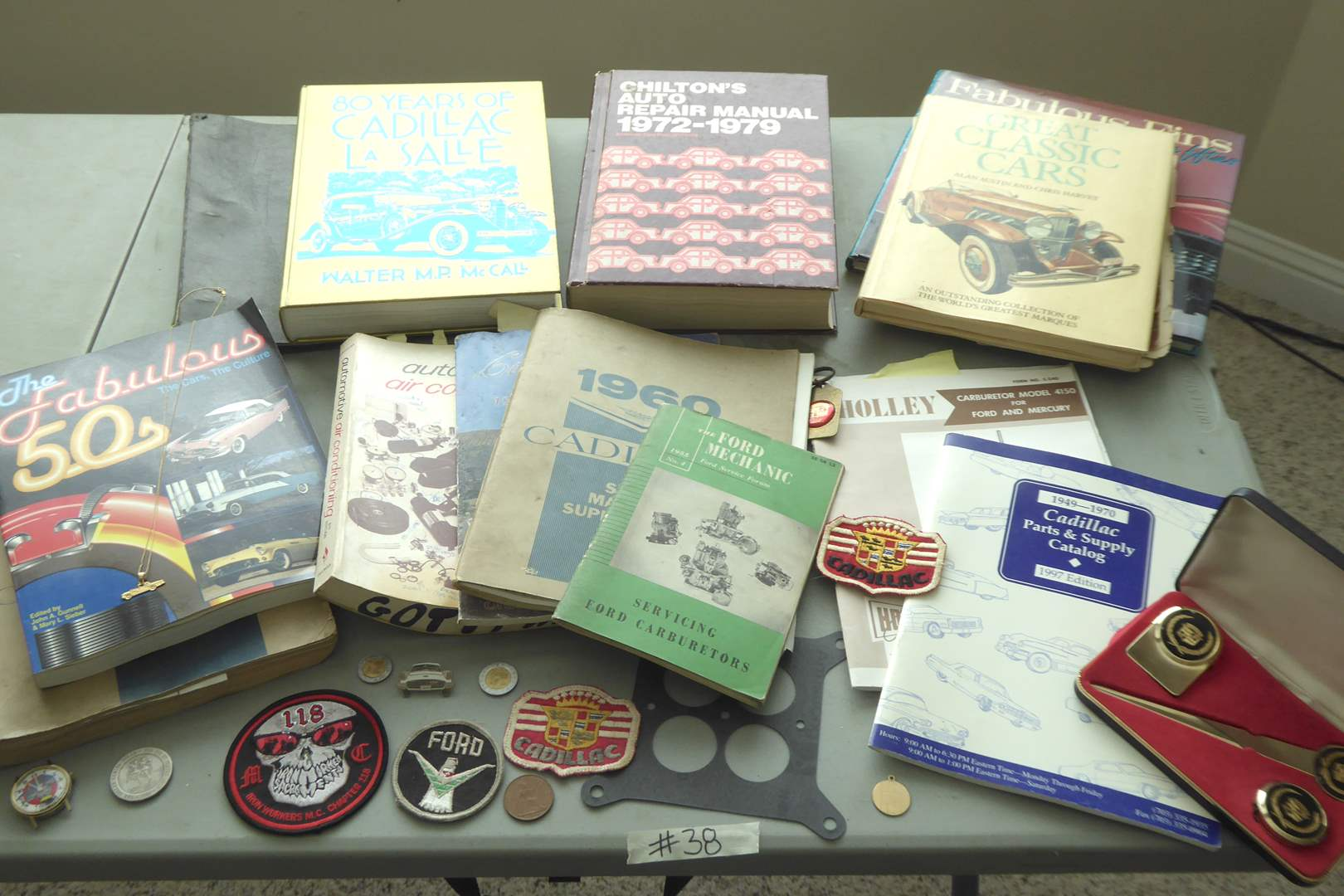 Lot # 38 - Cadillac & Classic Car Books, Coins & Patches  (main image)