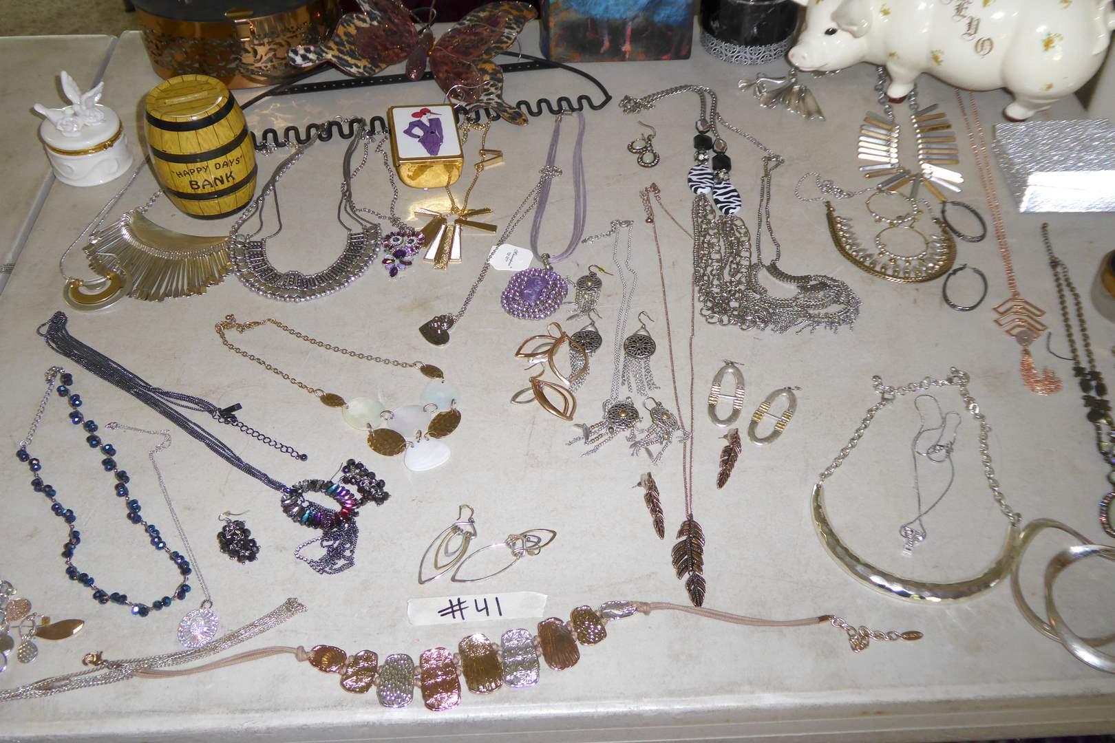Lot # 41 - Jewelry Lot & Ceramic Reno Piggy Bank  (main image)