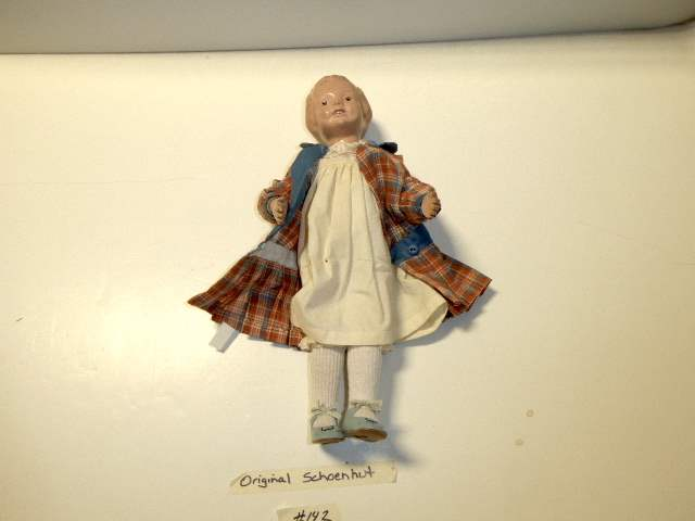 "Lot # 142 -  ""Early"" Schoenhut Carved Hair Doll (Blue Side Bow)  (main image)"