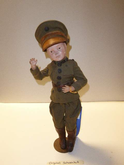 Lot # 144 - Schoenhut Wigged Doll (Soldier Clothing)  (main image)