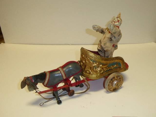 "Lot # 296 - Schoenhut Parade Wagon ""Chariot"" Clown & Burro  (main image)"