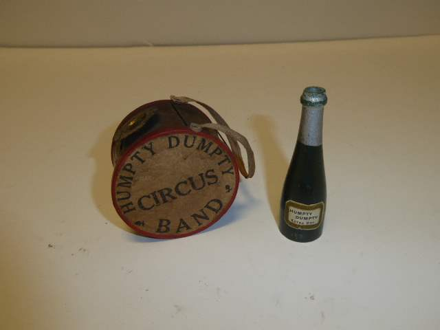 Lot # 305 - Schoenhut Humpty Dumpty Band Drum & Humpty Dumpty Extra Dry Champagne Bottle  (main image)