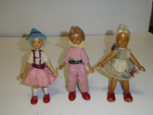 Lot # 312 - Three Wooden Dolls  (main image)