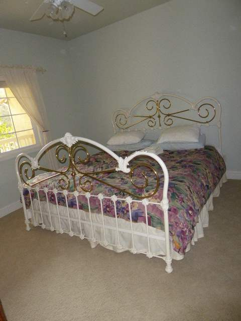 Lot # 11 - King Size Metal Bed Frame W/Mattress & Boxspring (Guest Bedroom)  (main image)