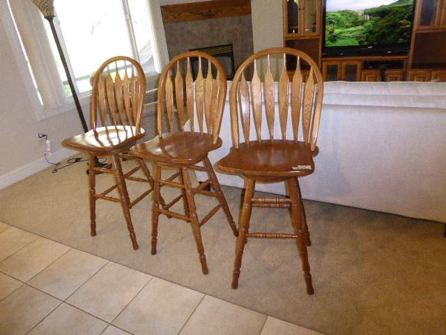 Lot # 13 - Three Oak Swivel Bar Chairs  (main image)