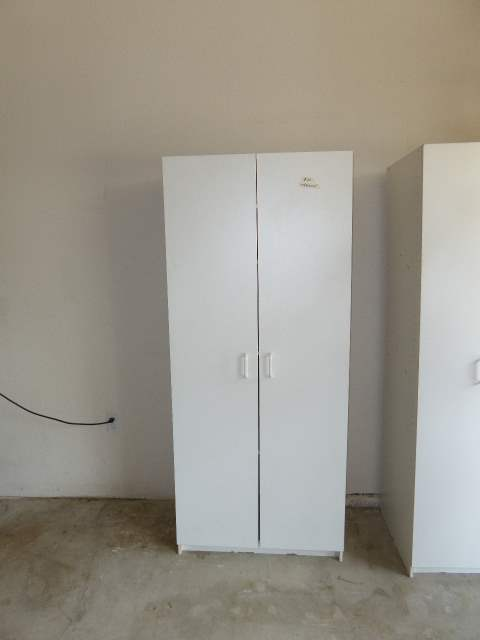 Lot # 20 - White Two Door Storage Cabinet  (main image)