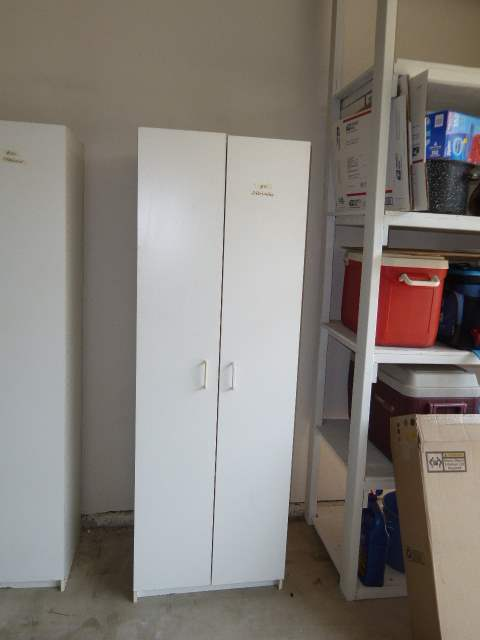 Lot # 21 - White Two Door Storage Cabinet  (main image)