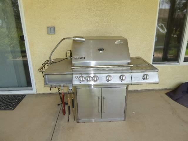 Lot # 24 - NexGrill Propane 4/Burner Grill w/Side Burner  (main image)