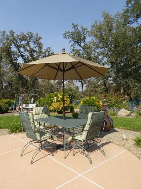 Lot # 26 - Metal Table W/Metal Rocking Chairs & Umbrella  (main image)
