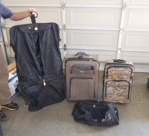 Lot # 76 - Rolling Suitcases & Garment Bag  (main image)
