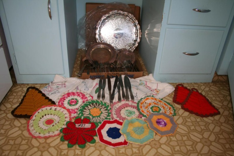 Lot #23  Needlepoint Table Coverings & Crocheted Hot Pads - Flatware & Silverplate (main image)