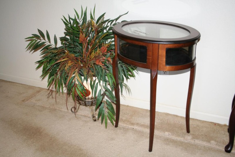 Lot #51 - Vintage Glass Top Curio Display Table and Potted Artificial Plant (main image)