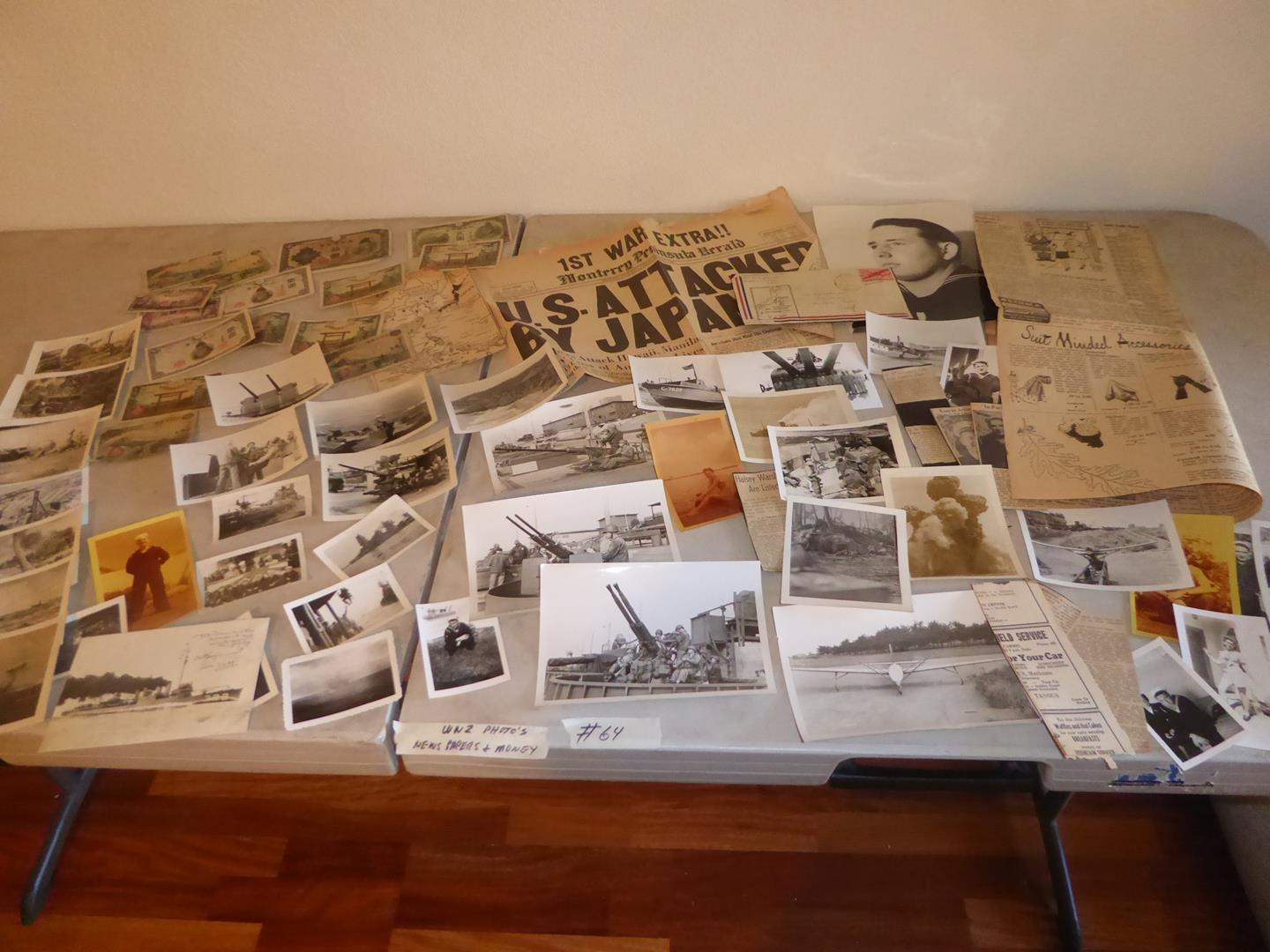 Lot # 64 - WWII Photos, News Paper Articles & Japanese Money (main image)