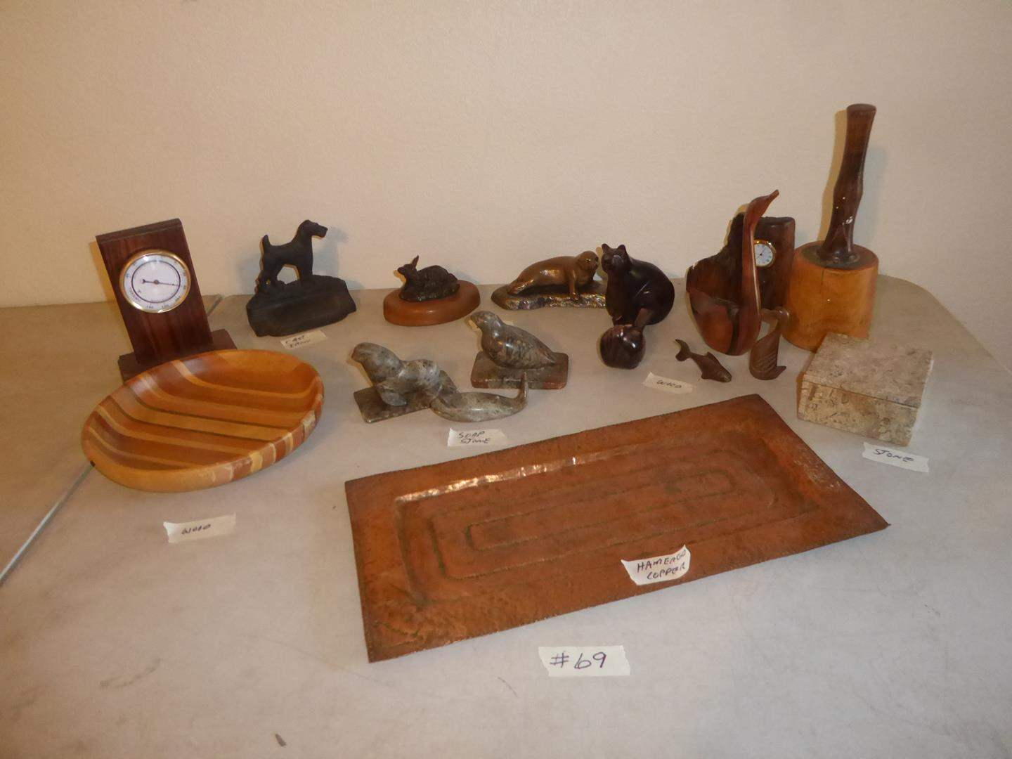 Lot # 69 - Hammered Copper Tray, New Zealand Wooden Bowl, Wooden Thermometer, Cast Iron, Soap Stone, Bronze & Wooden Figurines (main image)