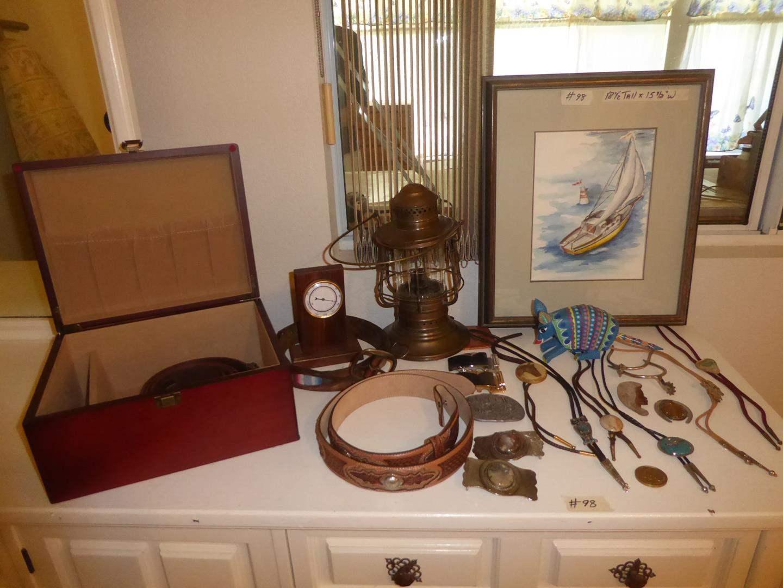 "Lot # 98 - Wooden Box, Men's Belt Buckles, Belts, Bolo Ties, Thermometer, Spurs, Framed Watercolor ""Ghost Dancer"" & Lantern (main image)"
