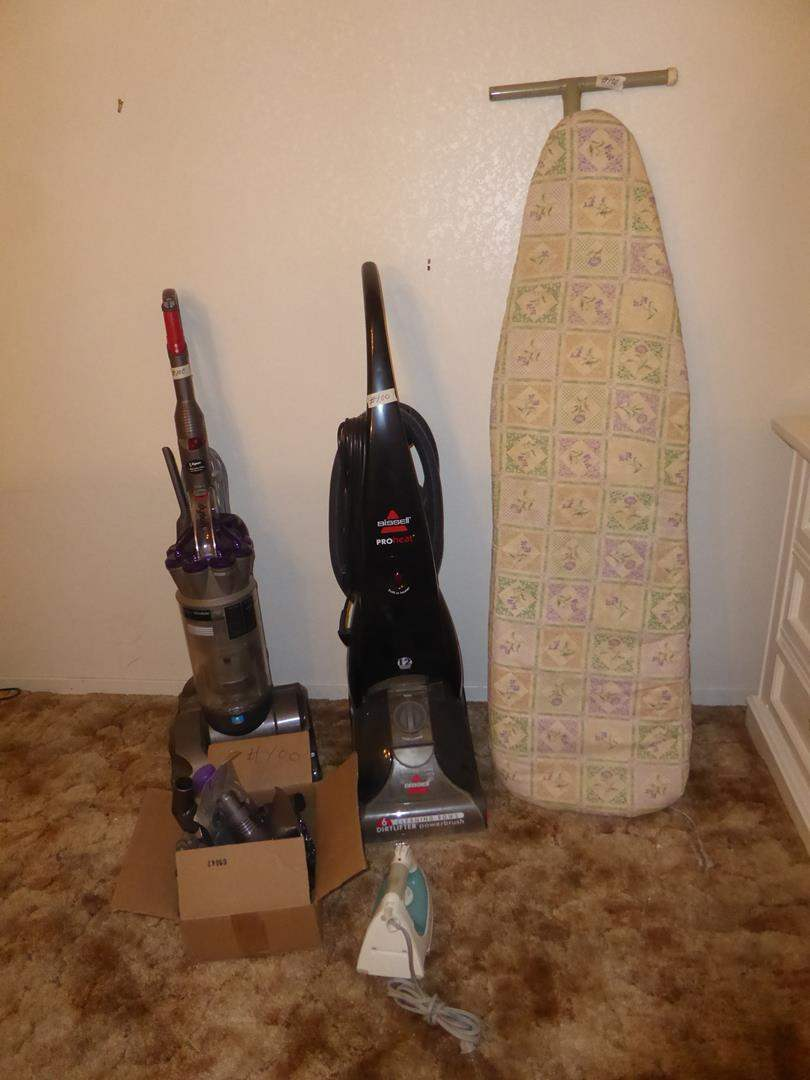 Lot # 100 - Dyson Absolute Animal Vacuum Cleaner, Attachments, Bissell Pro Heat Steam Cleaner, Rowenta Iron & Ironing Board (main image)
